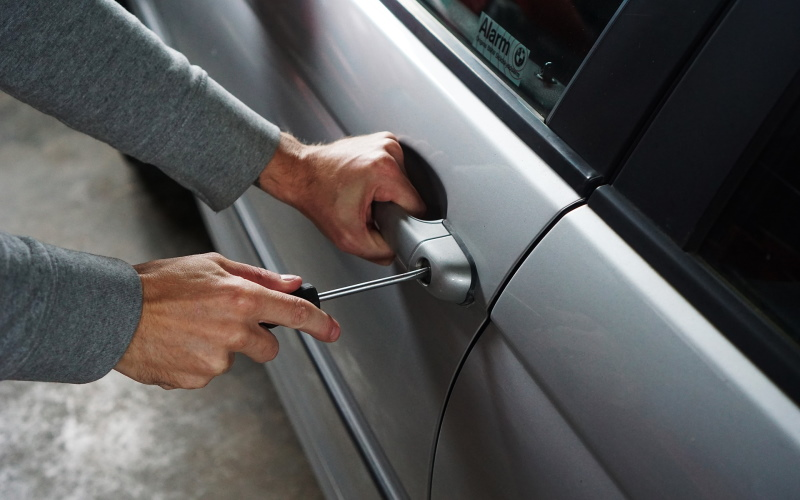 Thief Breaking Into Car