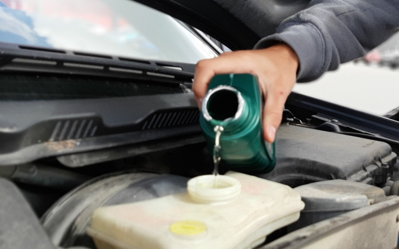 Liquid being poured into car