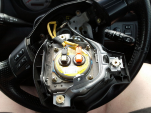 Air bag clock spring in wheel