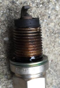 Dirty spark plugs are a common symptoms of a rich air/fuel mixture.