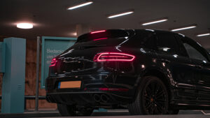 Pieter Benjamin Nijs Car parking building at night Unsplashed